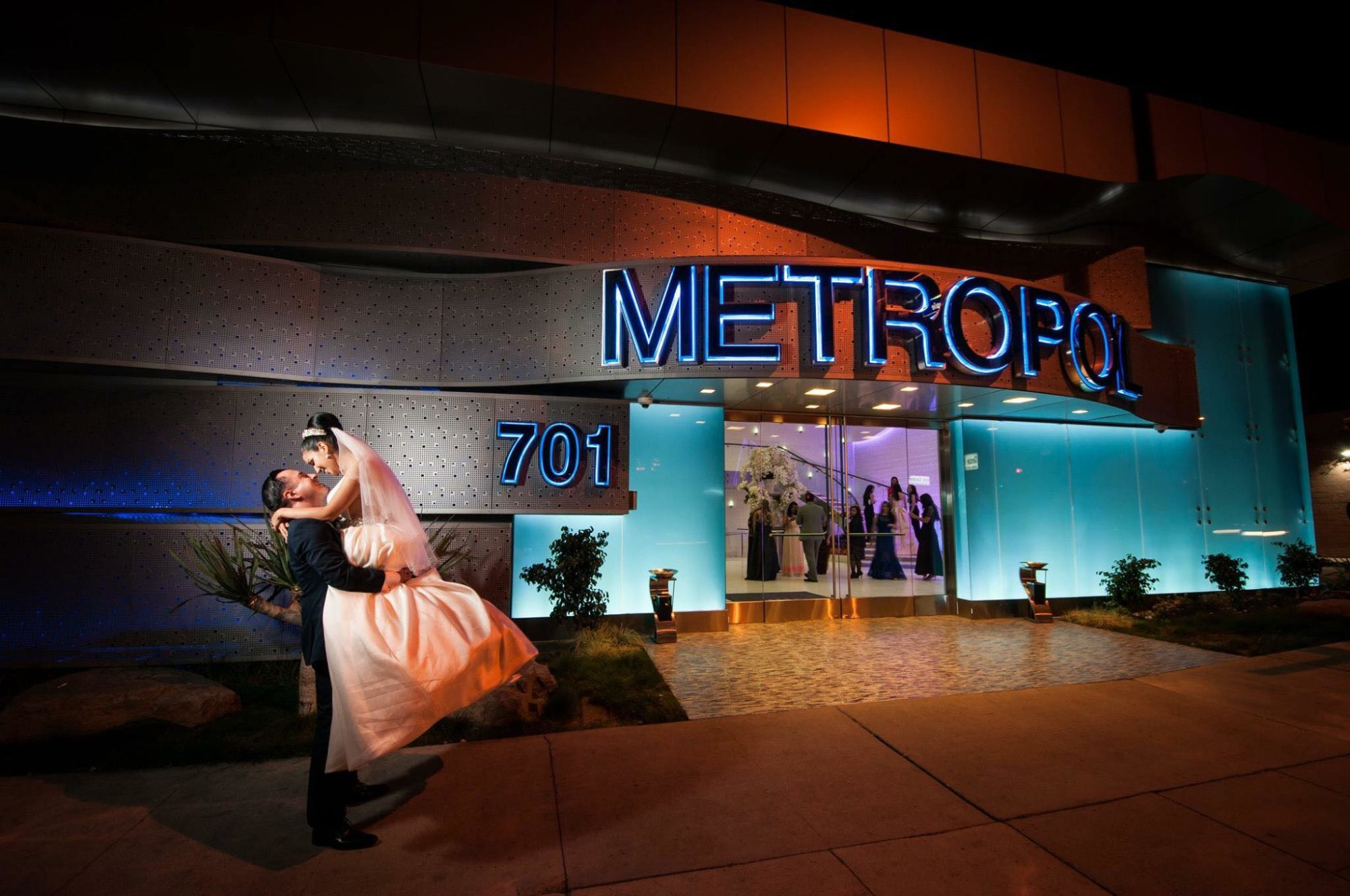 Newlywed Couple Kissing In Front of Metropol Banquet In Los Angeles CA