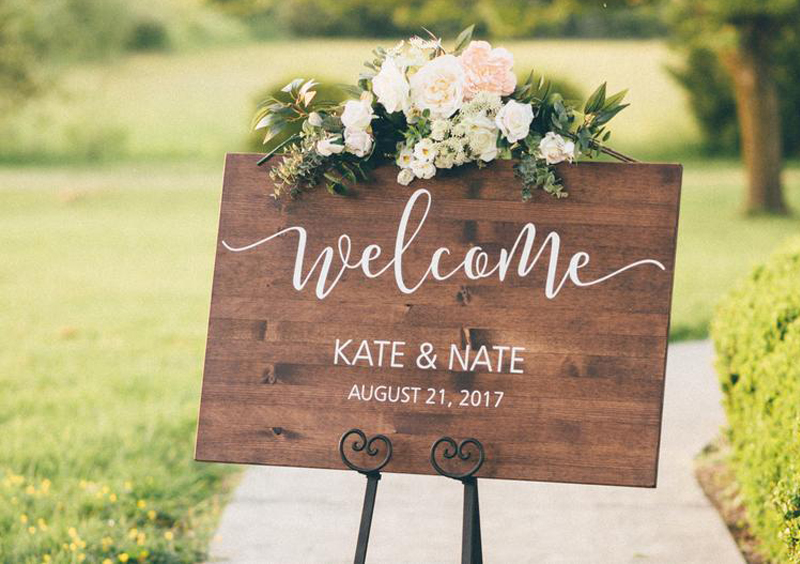 Disappearing Wedding Trends - Faux Wedding Calligraphy On Wooden Welcome Sign