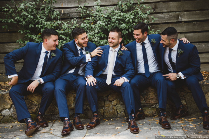 groomsmen sitting together. wedding day tips for the groom.