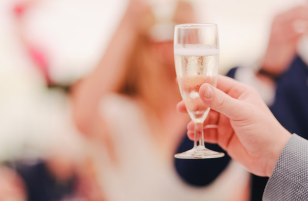 Man Giving Champagne Wedding Toasts