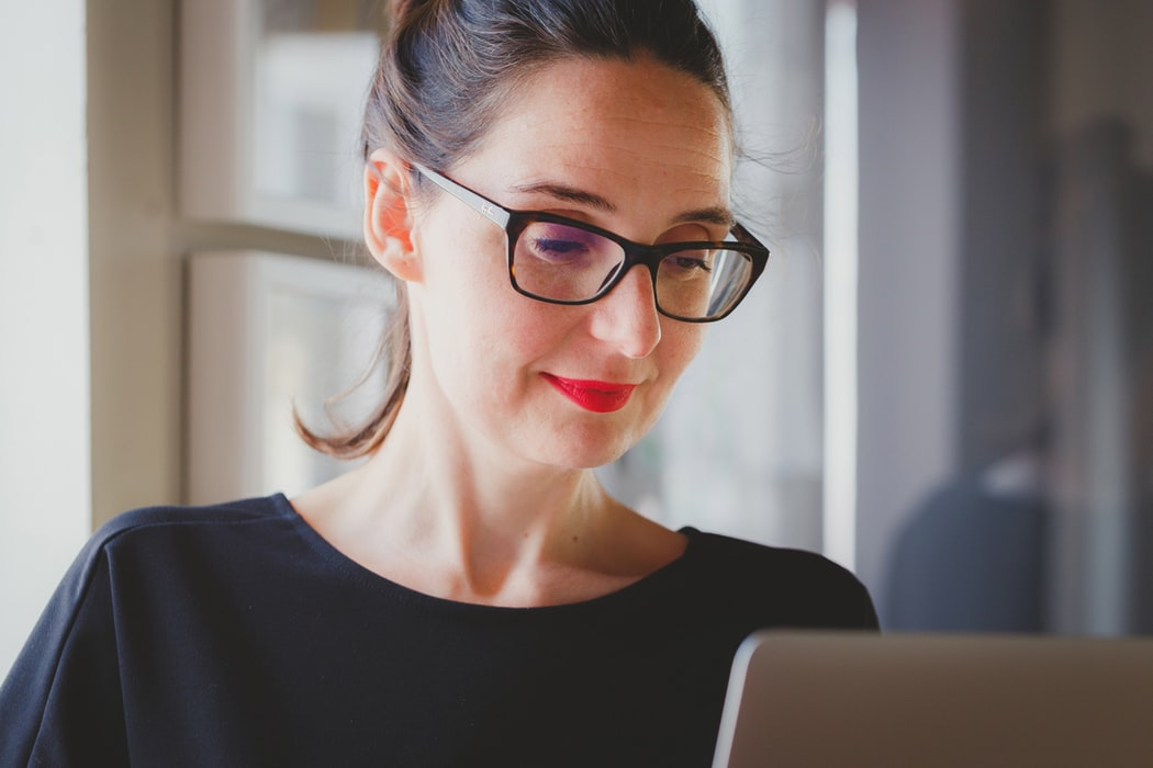 Brunette Wedding Planner Working At Laptop