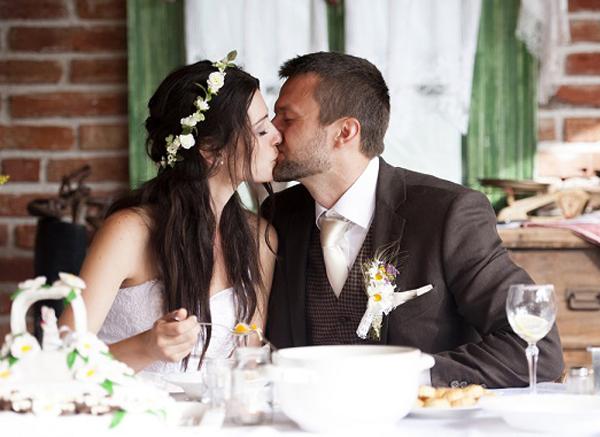 Brunette Bride And Groom Kissing At Wedding Celebration