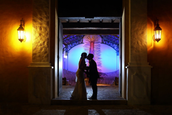Wedding Reception Entrance - Silhouetted Couple Kissing